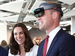 epa06093011 Britain's Prince William, Duke of Cambridge (R) looks through a Virtual Reality goggles as Catherine, Duchess of Cambridge (2-R) looks at him as they meet with young Polish entrepreneurs at the Heart business incubator in the Warsaw Spire building in Warsaw, Poland, 17 July 2017. The Duke and Duchess of Cambridge are on a first official visit to Poland.  EPA/LESZEK SZYMANSKI POLAND OUT