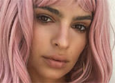 Topless Emily dons a pink wig and flaunts her derriere