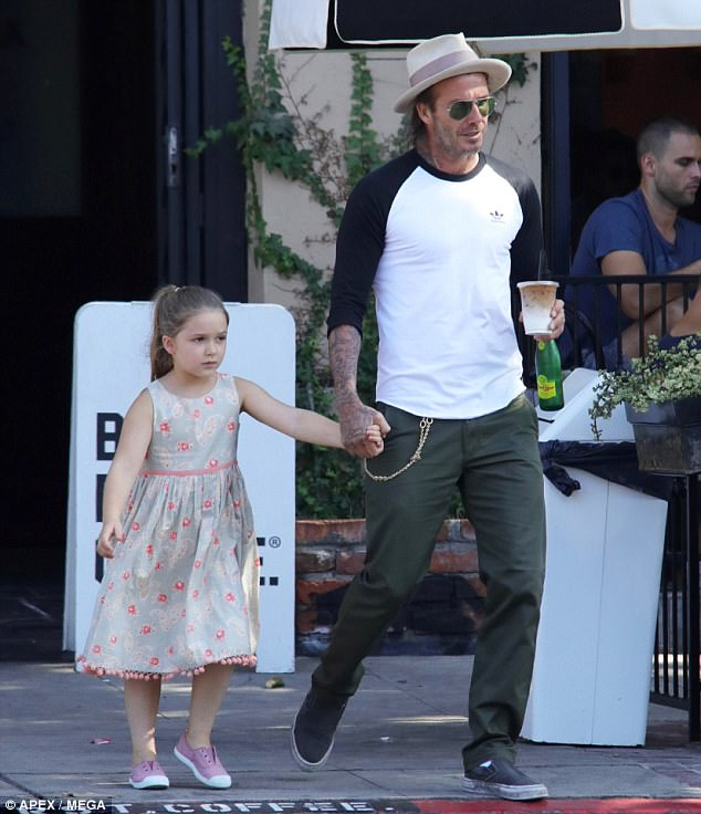 Outing: Earlier in the weekend, David was seen enjoying a casual outing with daughter Harper
