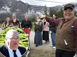 Winston Blackmore (right) has been found guilty of polygamy, here in a photo from 2008 with  six of his daughters and some of his grandchildren