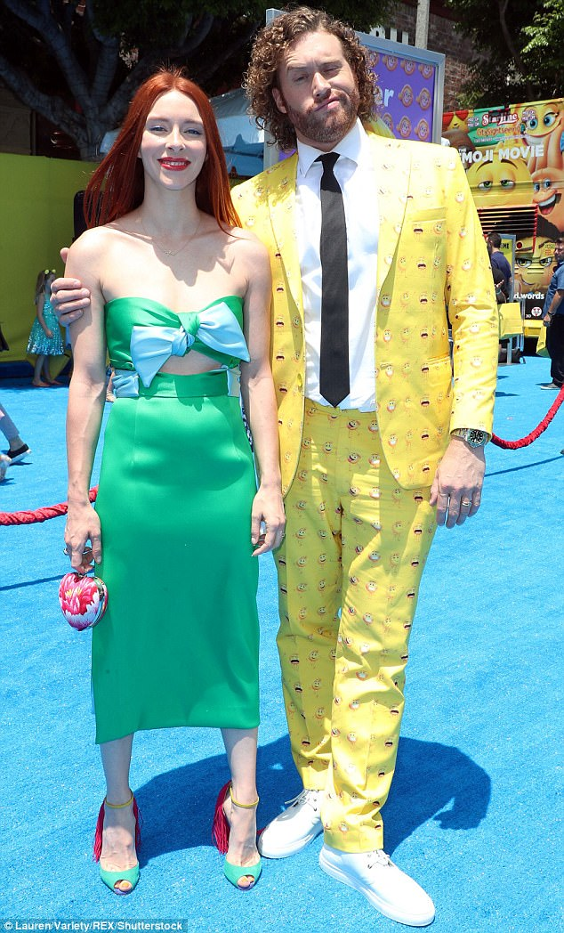 Green with envy! TJ's wife Kate Gorney contrasted the Deadpool actor in an strapless emerald green gown with baby blue bow across the bust