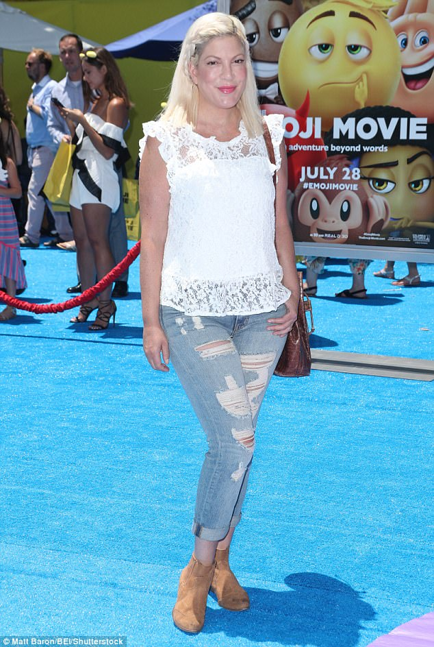 Mom in the house! Tori Spelling looked mommy chic in a lacy sleeveless top, ripped jeans, suede ankle boots and side-braided hairstyle