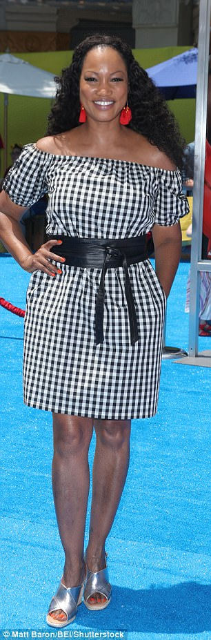 Checks please! Garcelle Beauvais looked pretty as can be in an off-the-shoulder checked number paired with silver espadrilles, red earrings and a thick leather belt