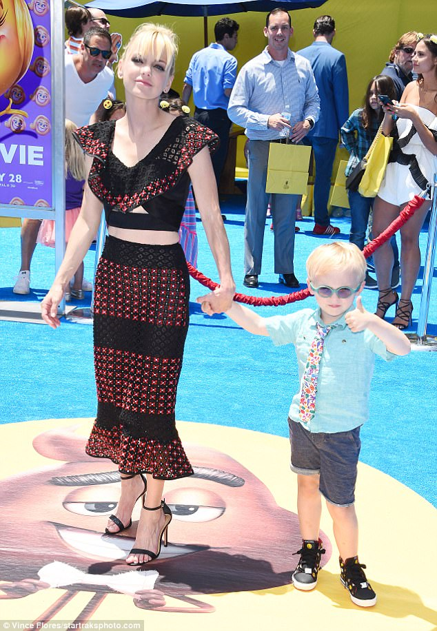 Tie guy: Anna and husband Chris Pratt's son Jacklooked cool as can be in a little blue polo, colorful tie, and emoji adorned sneakers