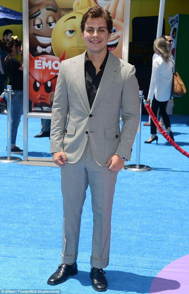 Wardrobe wizard!Jake T Austin of Wizards Of Waverly Place kept classic in a grey suit