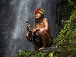 A shaman blasts his apprentice with a puff of dust in a decoration ritual in the middle of the dense Amazonian jungle.  The incredible set of photographs  show a witch doctor introducing his new apprentice to a sacred and hallucinogenic brew, performing a spirit journey over an open fire and teaching him the secrets of the forest
