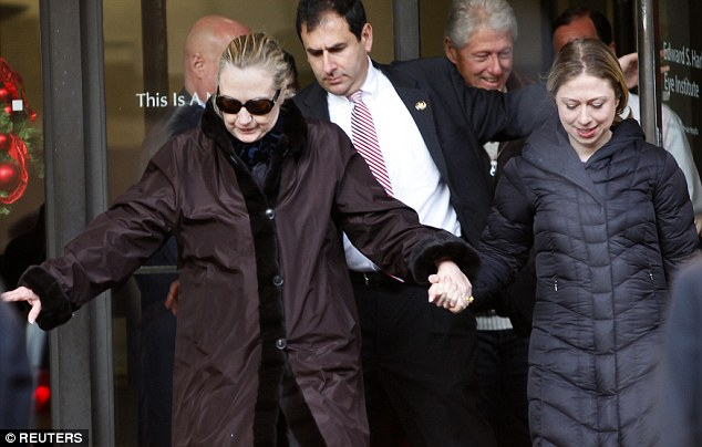 Clinton leaves New York Presbyterian Hospital with husband Bill and daughter Chelsea on January 2, 2013. The secretary of state, had not been seen in public since Dec. 7
