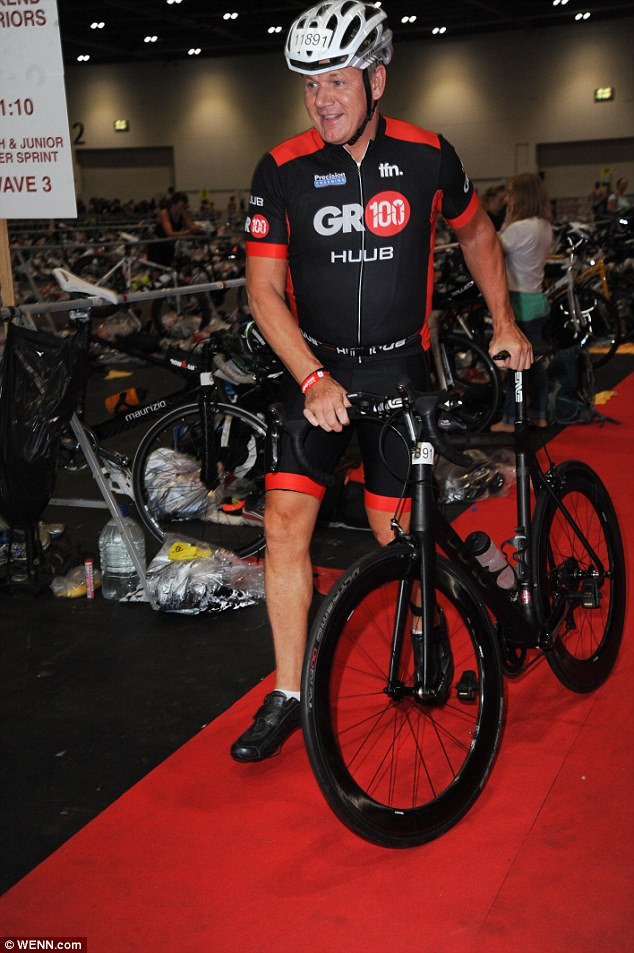 Working up a sweat: Clad head to toe in sportswear, the Michelin starred chef rolled his carbon fibre bike towards the tarmac where he completed a 40k cycle route