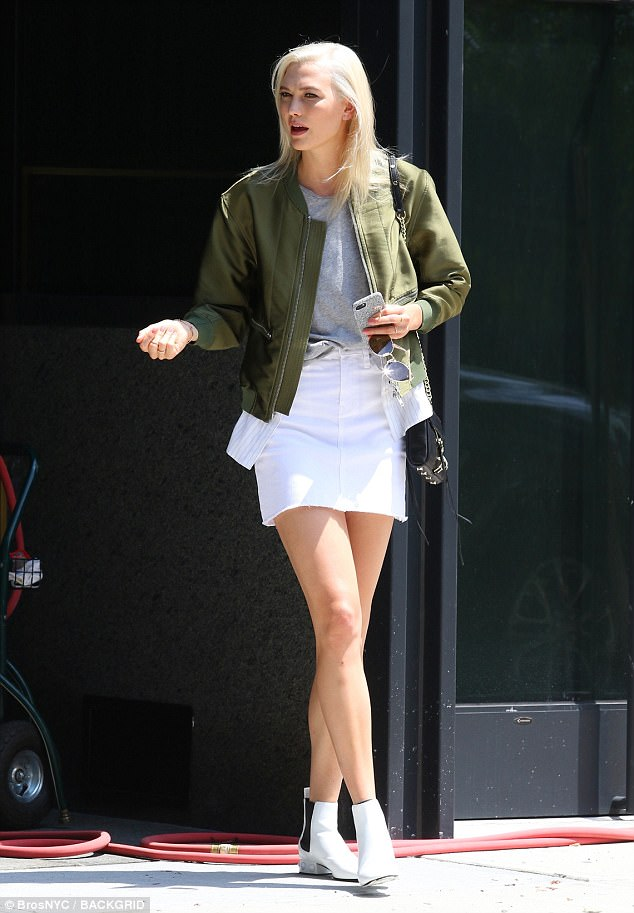 Leggy lady: Karlie Kloss, 24, was spotted in a variety of ensembles while filming a commercial in New York City on Sunday