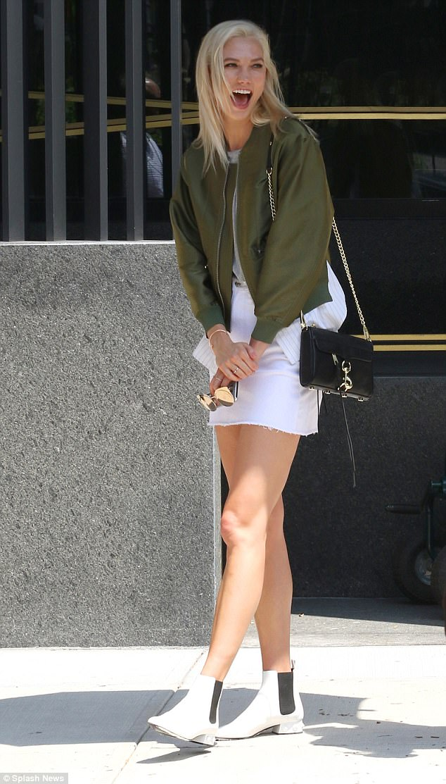 Chic shoes: She paired the look with a grey T-shirt and white boots that had a black panel