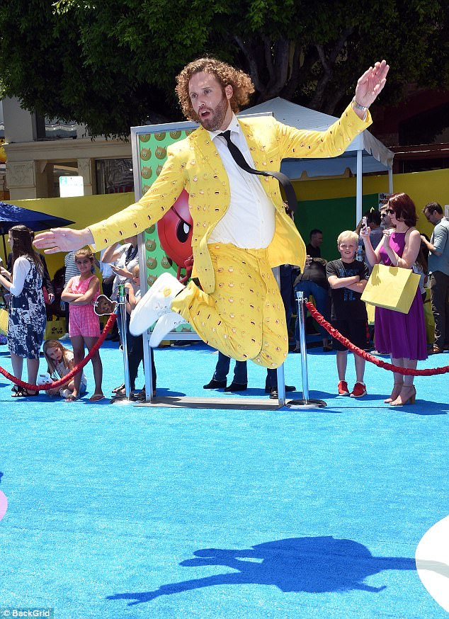 Taking the leap: Held at the Regency Village Theatre in Westwood, California, the premiere saw 36-year-old T.J. turn up in an emoji-patterned splashy yellow suit