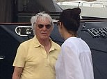 EXCLUSIVE Bernie Ecclestone and wife on a yacht in Ibiza  Bernie Ecclestone and his wife Fabiana Flosi is driven in a golf cart to his yacht on Ibiza. Once there he then had to struggle up the gangplank. Once aboard he disappeared inside the 58 meter long megayacht. Ibiza,  ©HGM press/Exclusivepix Media