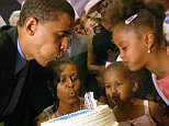 Former First Lady Michelle Obama posted two throwback pictures on Twitter Friday that show her husband celebrating his 43rd birthday in 2010, his second year in office