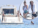 Mohamed Hadid celebrated his 'slap on the wrist' ruling from a long-running building violation by relaxing on his yacht with fiancee Shiva Safai in St Tropez on Thursday