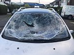 Cars have been vandalised in a street near Luton Airport, including this vehicle which had its windscreen and windows smashed