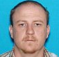 This undated photo released by the Missouri State Highway Patrol shows Ian McCarthy, of Clinton, Mo., who was charged Monday, Aug. 7, 2017, with first-degree murder and armed criminal action in the fatal shooting of Clinton police officer Gary Michael during a traffic stop on Sunday. Authorities were searching for McCarthy Monday in the Clinton area. (Missouri State Highway Patrol via AP)