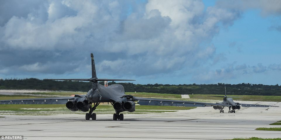 The two bombers (above at take off) flew in the vicinity of Kyushu, Japan, the East China Sea, and the Korean peninsula. The U.S. released photos of the mission late Tuesday seemingly in response to North Korea's threat to strike Guam