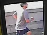 A man has been arrested after shocking CCTV revealed the moment a jogger pushed a woman in front of a bus on Putney Bridge (pictured)