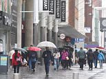 Good old British summer: People brave the rain in Southampton yesterday morning. Despite it being the height of summer, the British havebeen complaining about August washout for centuries