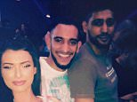 Amir Khan parties in Duabi with his brother Haroon (middle) and Bia Hannides (left)