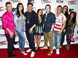 "FILE - This Oct. 24, 2012 file photo shows ""Jersey Shore"" cast members, from left, Mike ""The Situation"" Sorrentino, Jenni ""JWoww"" Farley, Paul ""Pauly D"" Delvecchio, Deena Cortese, Vinny Guadagnino, Ronnie Ortiz-Magro, Sammi ""Sweetheart"" Giancola and Nicole ""Snooki"" Polizzi at a panel entitled ""Love, Loss, (Gym, Tan) and Laundry: A Farewell to the Jersey Shore"" in New York. The cast of ""Jersey Shore"" is doing it all again for a special on the E! Network. ""Reunion Road Trip: Return to the Jersey Shore"" brings the gang back together for the first time in five years. It airs Aug. 20, 2017. (Photo by Charles Sykes/Invision/AP, File)"