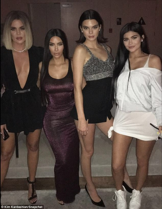 Kicking off a new trend: Kylie flashed her her legs and derriere in a skintight white dress, which she knotted along the hemline; she added a loose zippered hoodie