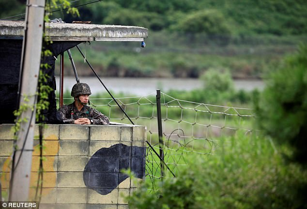 A South Korean soldier stands guard at a guard post near the demilitarised zone separating the two Koreas in Paju, South Korea