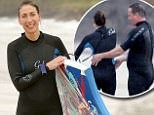 EXC PRINT BEFORE WEB / David & Samantha Cameron seen enjoying time on Polzeath Beach (Fri 11 Aug 2017). David helps Samantha into her wetsuit before she goes bodyboarding in the Cornish waves.  / captured by local photography student