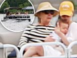 Boat over troubled water: Hillary and Bill Clinton are on vacation in the village of North Hatley in Quebec this week (Hillary and Chelsea above with baby Aidan)