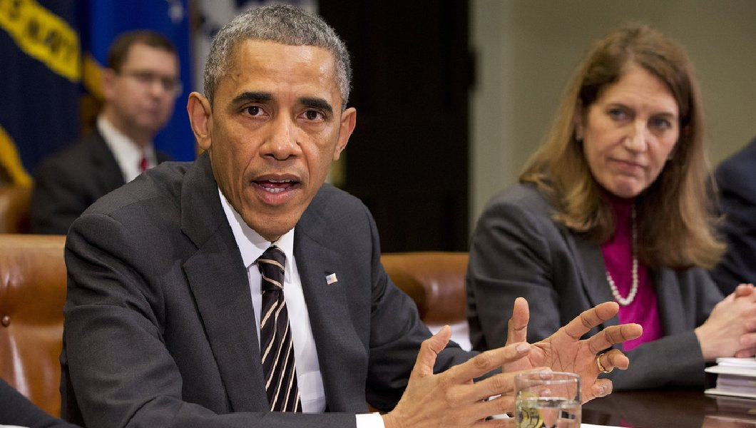 A Texas judge has temporarily blocked the Obama administration's new requirements for transgender care. Above, President Obama sits next to Health and Human Services Secretary Sylvia Burwell. (AP Photo/Jacquelyn Martin)