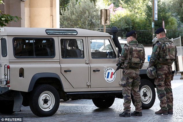 Soldiers secure the street near the scene where French soldiers were hit and injured by a vehicle in the north western Paris suburb of Levallois-Perret