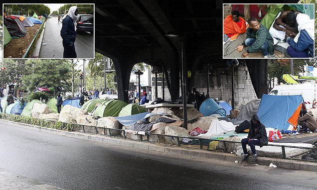 Refugees and migrants live in makeshift camp in Paris