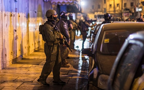 Israeli police secure the area after a drive-by shooting in East Jerusalem