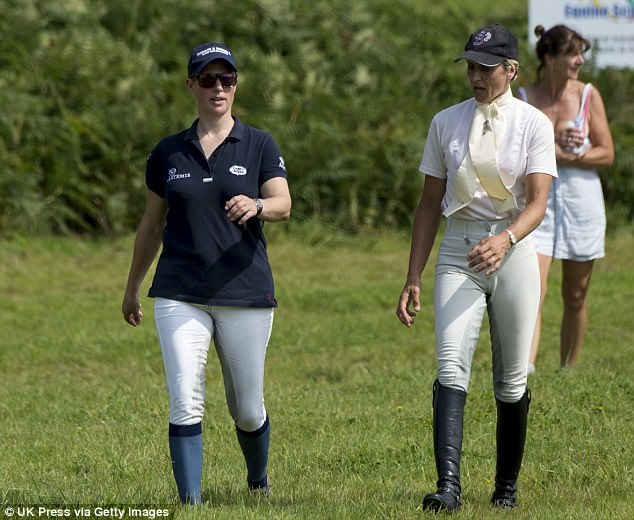 The royal looked relaxed in a black t shirt and jodphurs as she chatted with a fellow rider