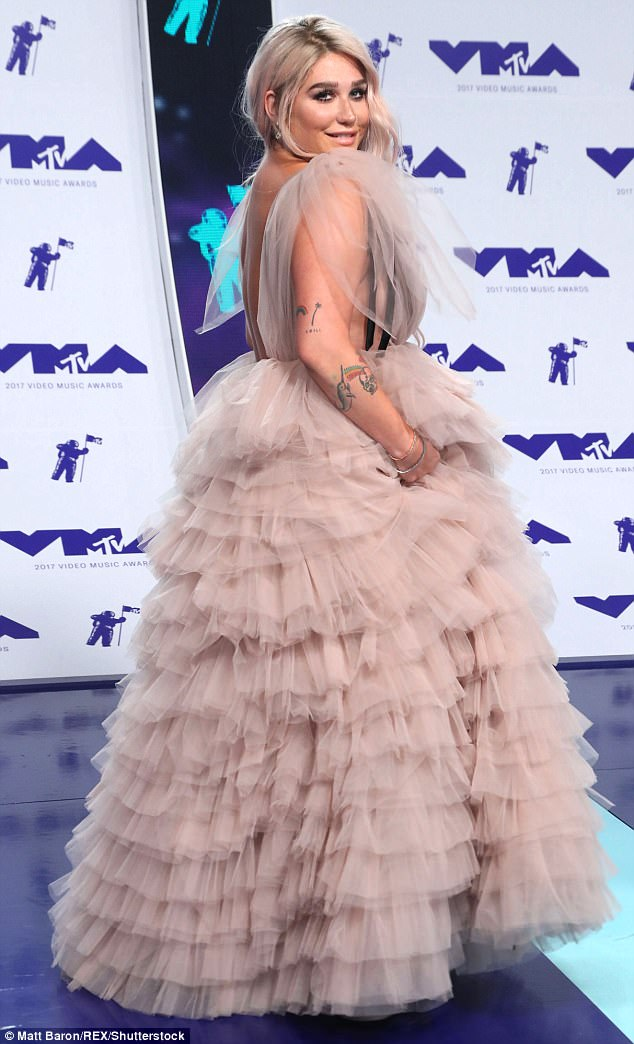 All dolled up: Kesha wore afluffy pink Monsoori gown for the award show