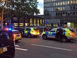 Police vehicles are pictured outside Euston Station in London shortly after it was evacuated today