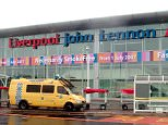 Passengers said they are being held onboard aircraft at John Lennon Airport in Liverpool due to an ongoing security alert (file photograph)