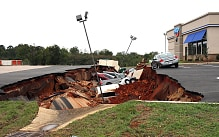 Vehicles following a cave-in of car park in Meridian, Mississippi