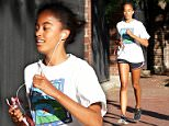 Malia Obama pictured on Wednesday going for a run around the campus in Harvard Square
