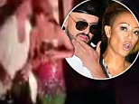 Getting close: The mystery man was seen kissing Mel B on the forehead in exclusive DailyMail.com video. A clubgoer said they also kissed on the lips