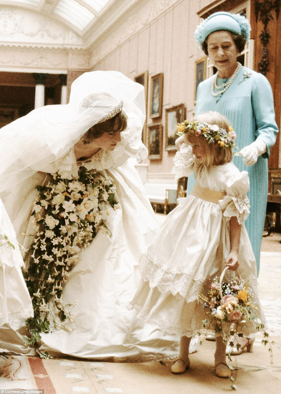 Don't be nervous: Diana chats to five-year-old bridesmaid Clementine Hambro under the watchful eye of the Queen