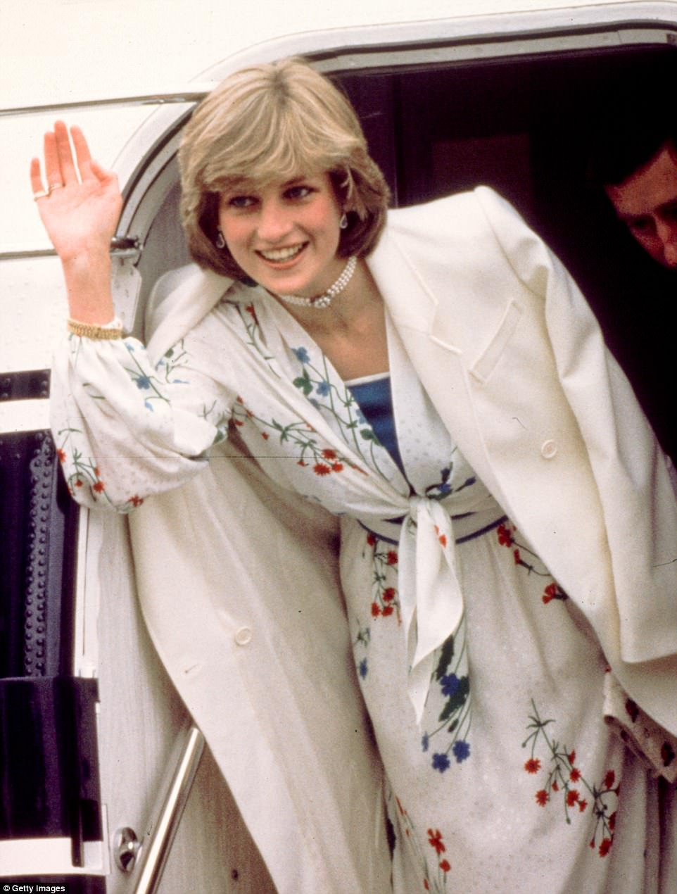 Flower power: Diana wore a Donald Campbell silk dress and cashmere coat from Courtenay House in Mayfair for a flight to the Royal Yacht Britannia as part of her honeymoon