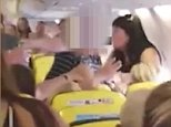 In a video of the brawl, men and women aboard the Newcastle to Alicante Ryanair flight can be seen scrapping over the tops of seats