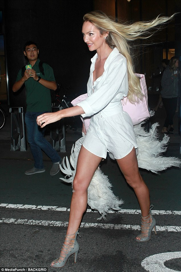 Stepping out: She further elongated her legs with a pair of lace up grey high heels