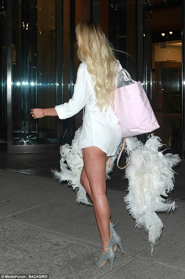 Cheeky: Candice's dress skimmed over her pert derriere