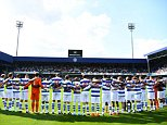 Players line up at the Queens Park Rangers ground at Loftus Road in remembrance of the victims of the Grenfell Tower fire