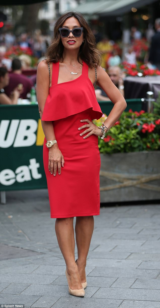 A touch of Klass: The radio personality drew attention to her incredibly tiny waist with the ruffle which featured as part of the form-fitting frock