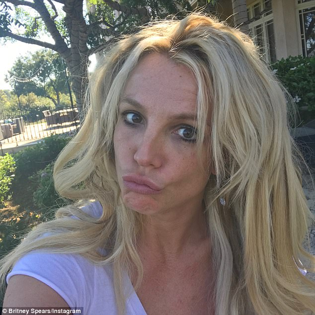 Relaxed: The 35-year-old hitmaker pulled faces as she took the snaps with her tousled blonde hair, dark roots showing, falling down around her shoulders