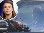 Rooney was wearing his wedding ring when he was seen arriving at Everton 's training ground in his black Range Rover today