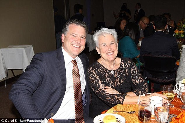 Carol Sue Kirken (right) died on Saturday in the arms of her son Robert (left) after a hippopotamus attacked her on a safari in Tanzania
